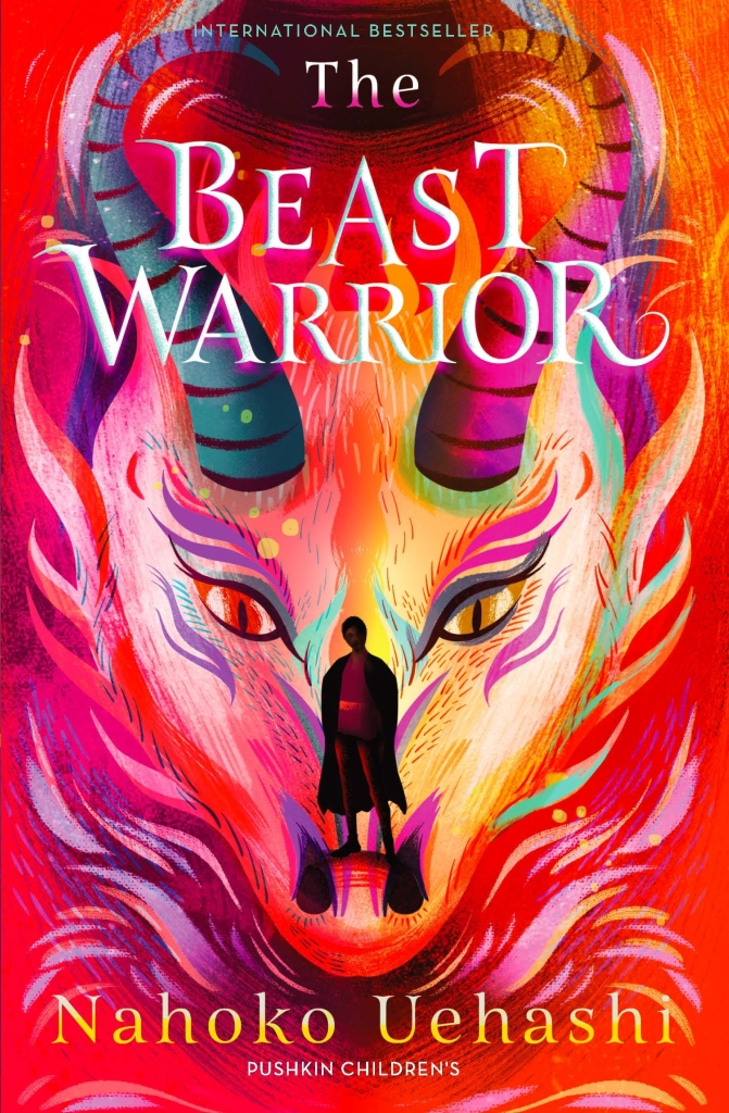 The Pushkin Children's UK cover  for The Beast Warrior. Red and pink hues with a dragon-like face with the silhouette of a person on the nose.